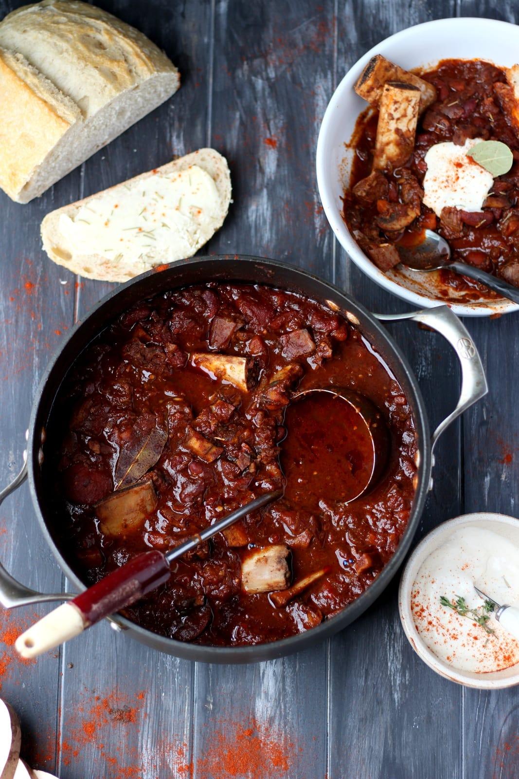 Braised Beef Short Rib Chili + Horseradish Sour Cream - amazing chili recipe with braised short ribs, mushrooms, leeks and whole tomatoes. thewoodenskillet.com #fallfood #foodphotography