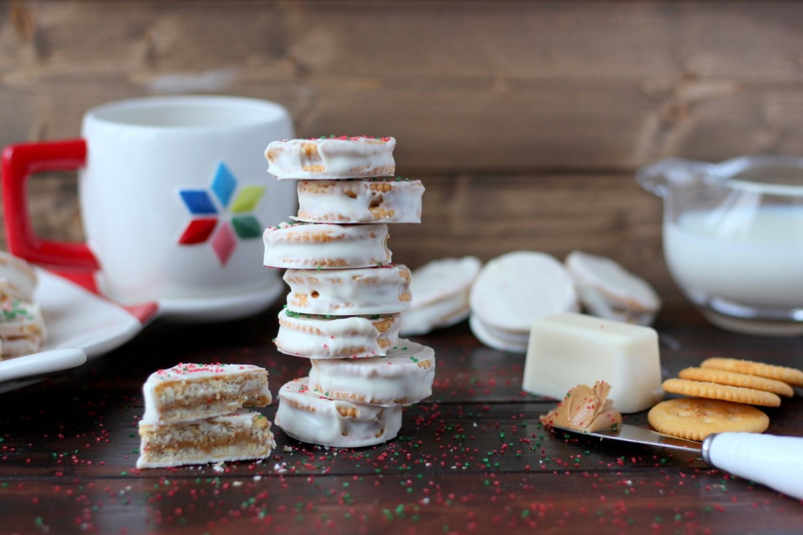 Classic White Chocolate + Peanut Butter Dipped Christmas Cookies - no bake and simple, these cookies will become your new family favorite this holiday season! thewoodenskillet.com