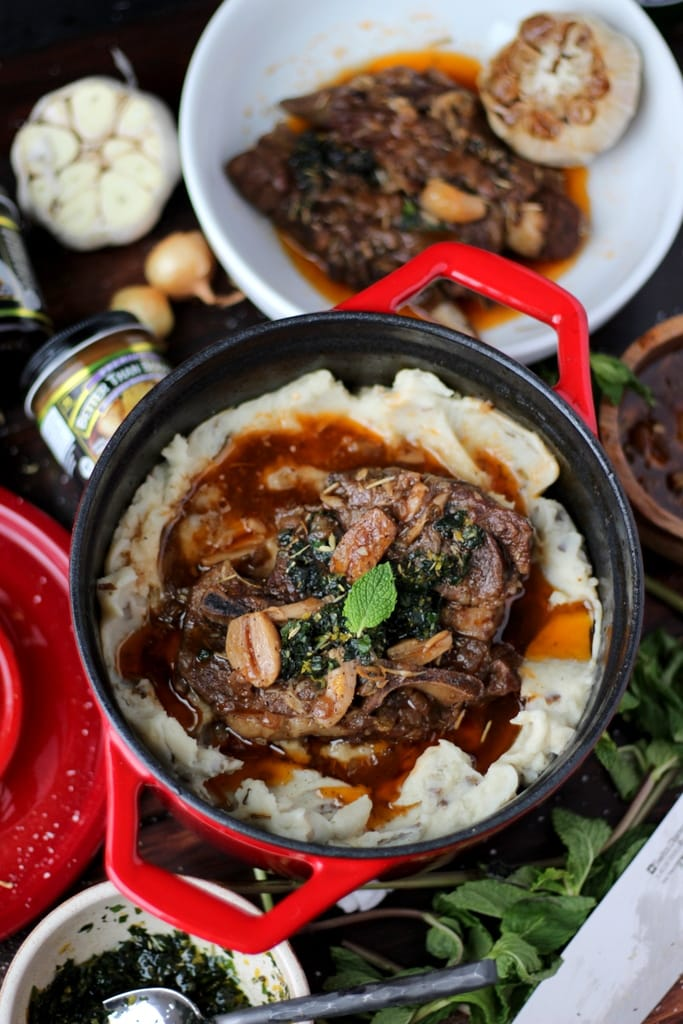 Braised Lamb Shoulder + Mint Gremolata and Roasted Garlic Mashed Potatotes - the perfect holiday meal! thewodenskillet.com