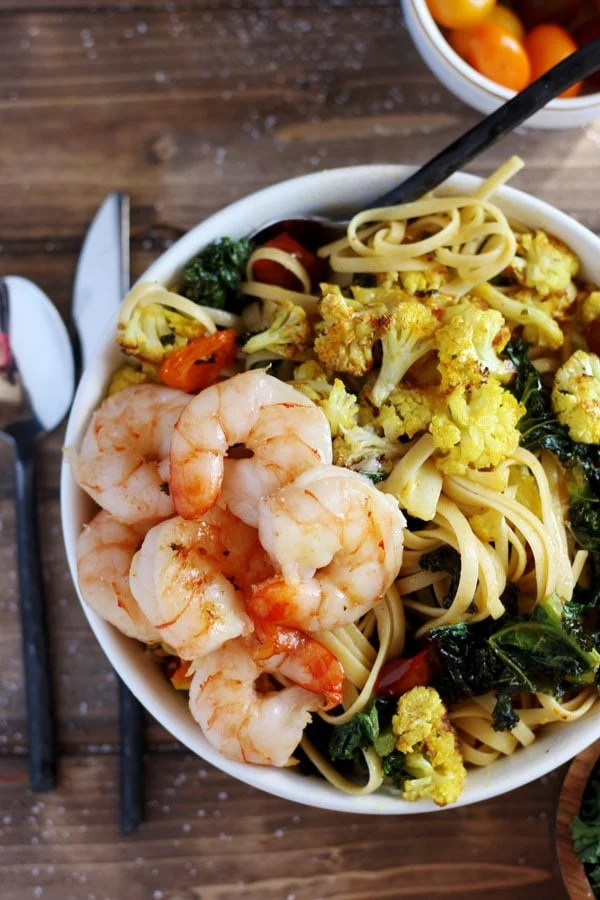 Roasted Turmeric Cauliflower, Kale and Shrimp Pasta + Brown Butter. Simple enough to make on a weeknight, but perfect for a weekend dinner party! thewoodenskillet.com
