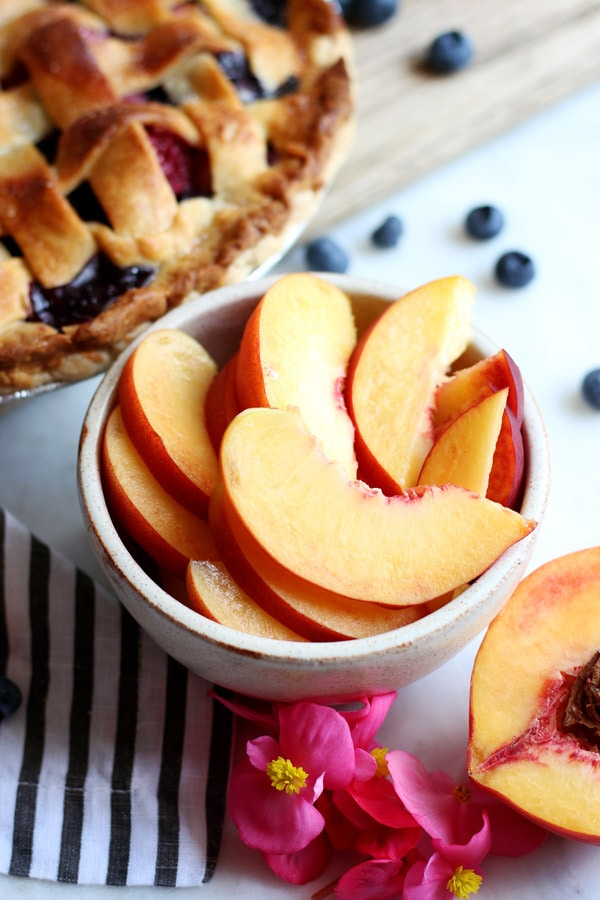 Peach, Raspberry and Blueberry Summer Pie - easy, delicious and a great way to use your summer fruit! - thewoodenskillet.com