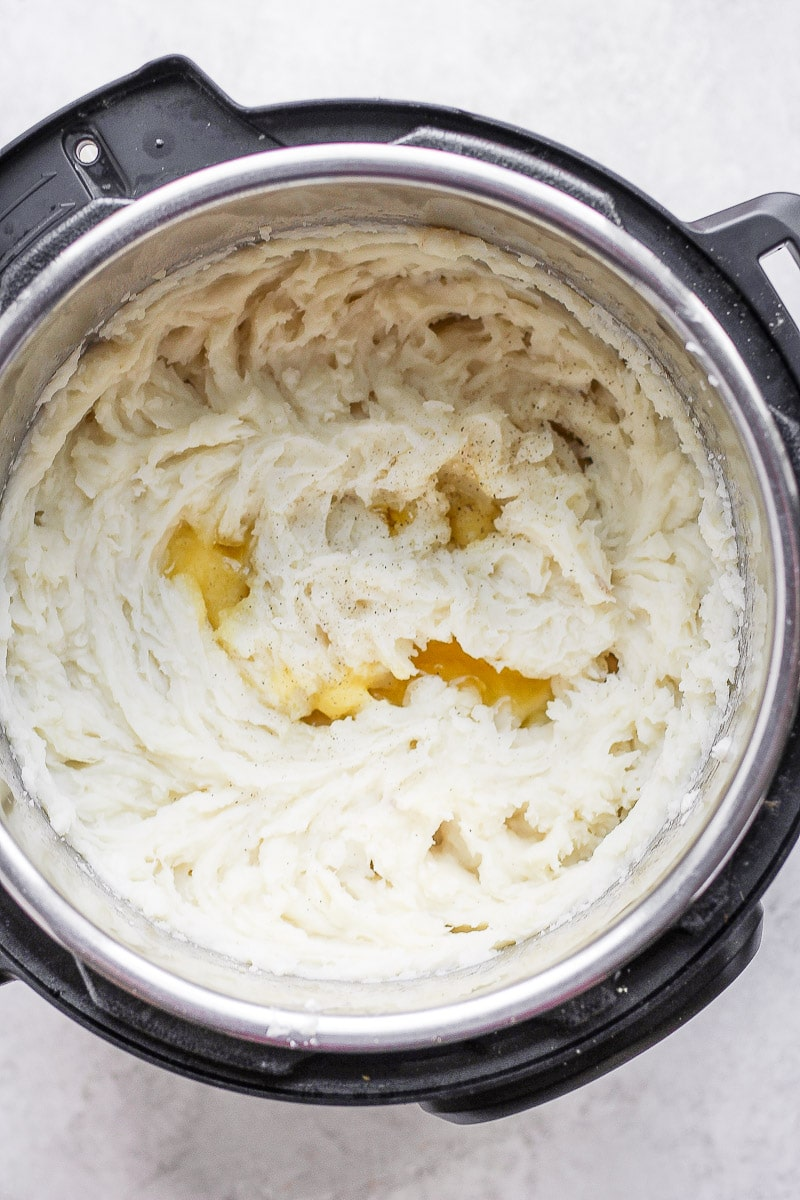 Mashed potatoes in an Instant Pot that have been whipped with a hand mixer + some melted ghee.