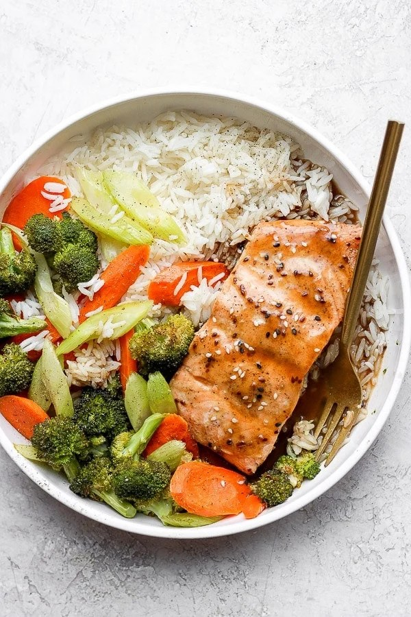 Bowl of teriyaki salmon with vegetables and jasmine rice.