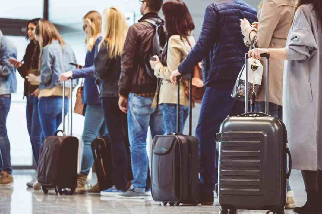 As Airport Screenings Near A Pandemic Peak; The CDC Advises Americans To Avoid Traveling