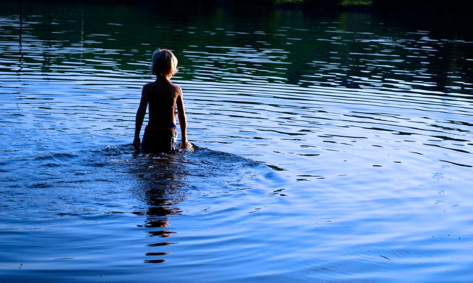 boy crosses water