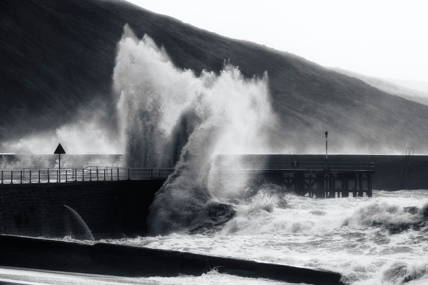 Spectacular wave explodes onto the wharf, by Craig Kirkwood
