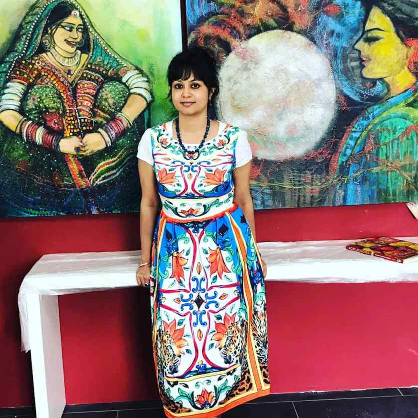 Brindarica with some of her paintings