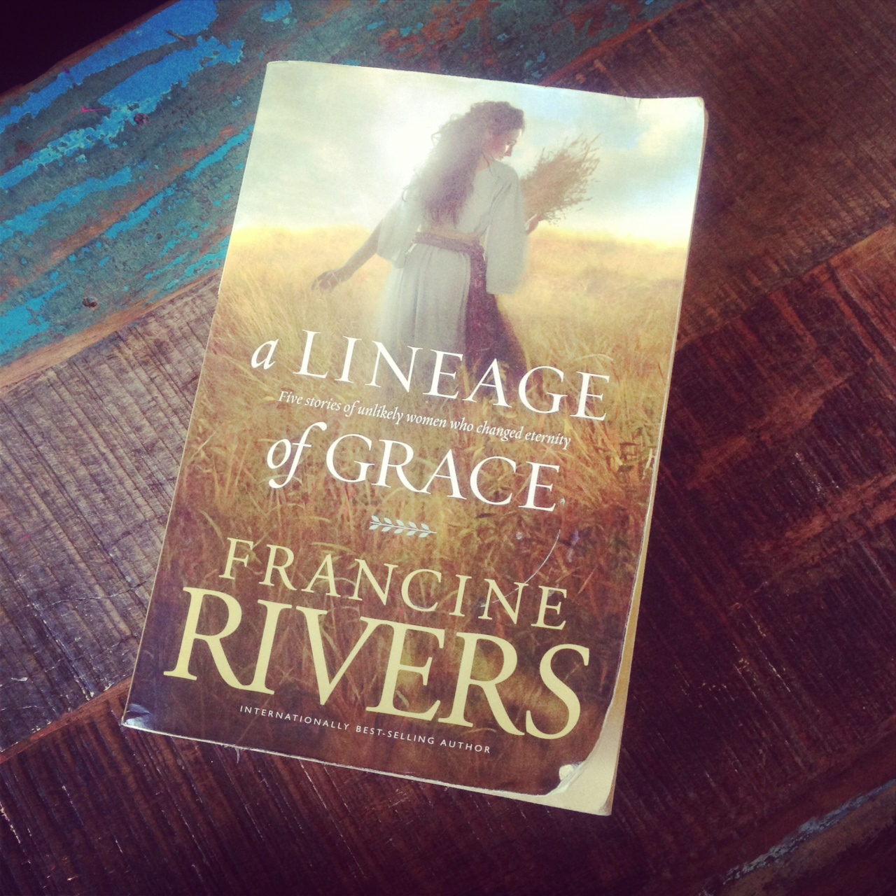 francine rivers a lineage of grace book sitting on a wooden table
