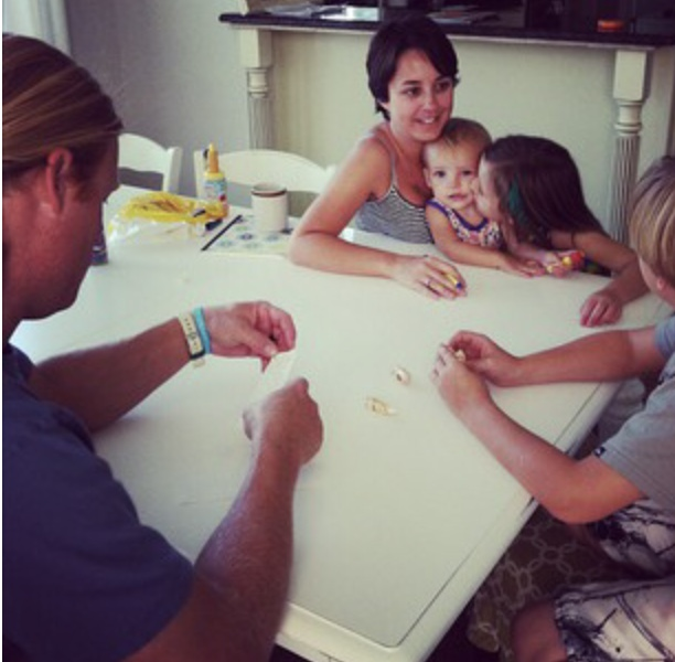 Family writing notes to put inside shell for sharing gospel