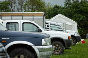 4x4 Vehicles lined up with a stock trailer (office) and catering tent