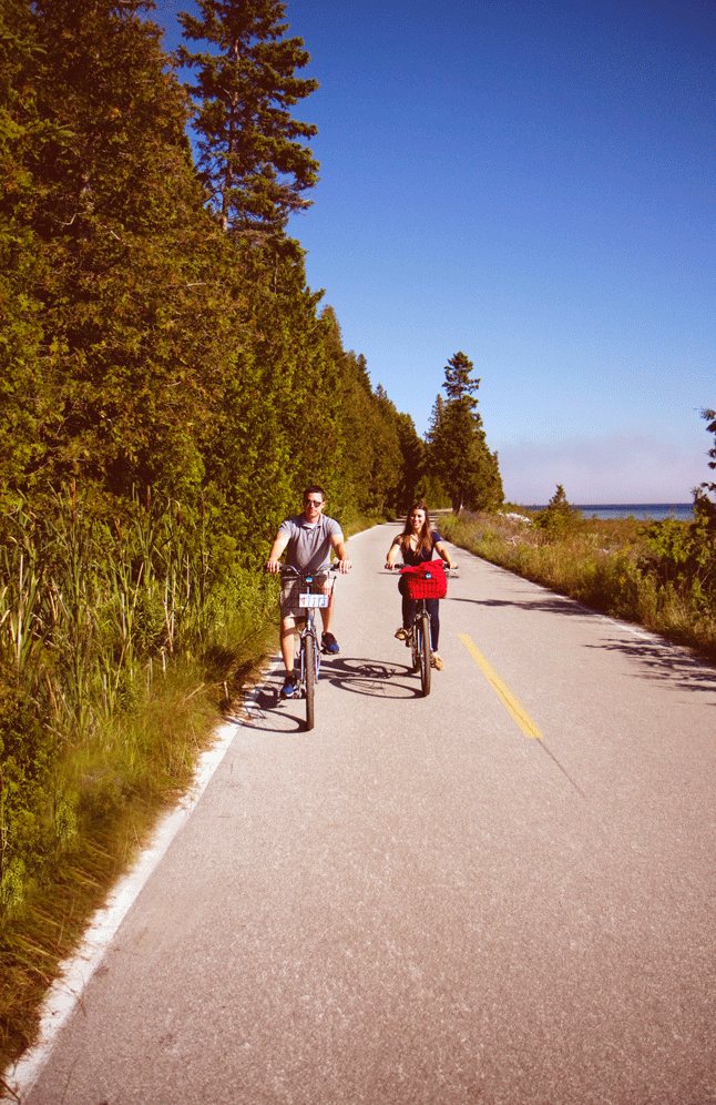travel blogger Amanda biking around Mackinac Island, Michigan.