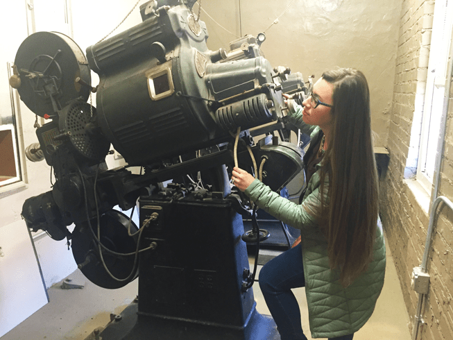 an old fashioned movie projector from the old theatre days