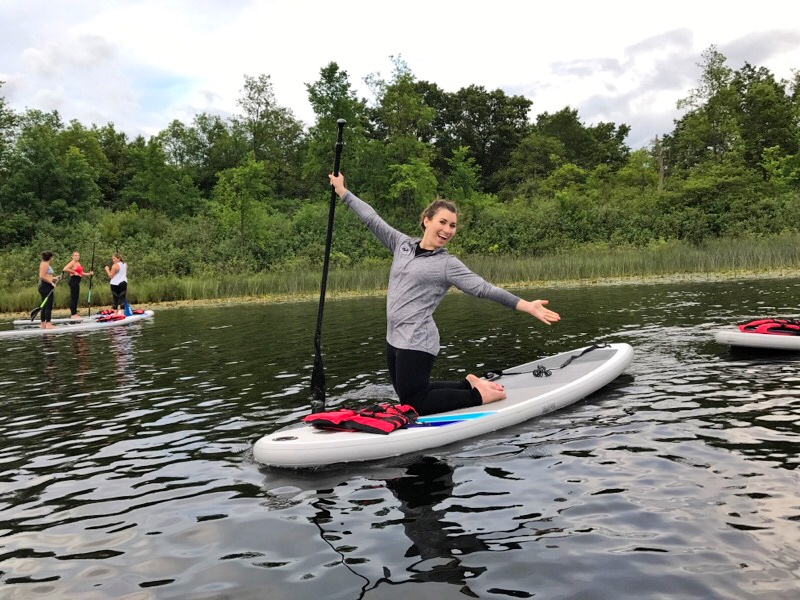 stand up paddle yoga with game on paddle boards in Lake Orion
