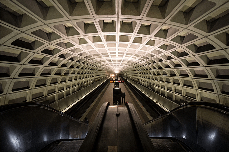 inside the metro station in Washington, DC. A symmetrical photo of the underground.