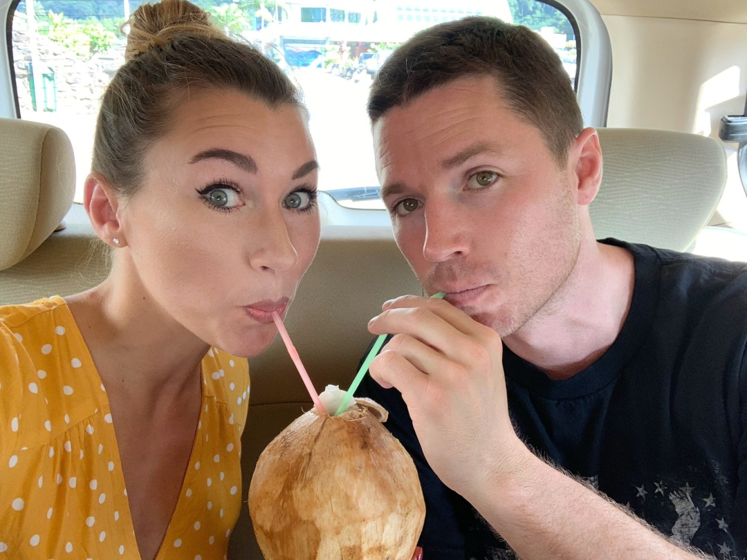 travel blogger Amanda drinks fresh coconut in Tahiti