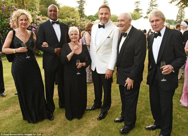 Garden party: (L-R) Fiona Hawthorne, Colin, Dame Judi, David, Michael G Wilson and David Mills
