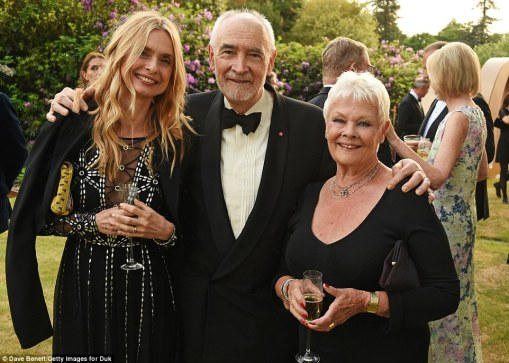 Flashback: Former Bond girl Maryam (who starred in 1987 Bond film The Living Daylights) and Bond producer and screenwriter Michael G Wilson chatted to Dame Judi Dench over champagne