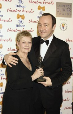 LONDON - FEBRUARY 22: Dame Judy Dench and Kevin Spacey attend the 2004 Laurence Olivier Awards at The Park Lane Hilton Hotel on February 22, 2004 in London. (Photo by Dave Benett/Getty Images) *** Local Caption *** Dame Judy Dench;Kevin Spacey