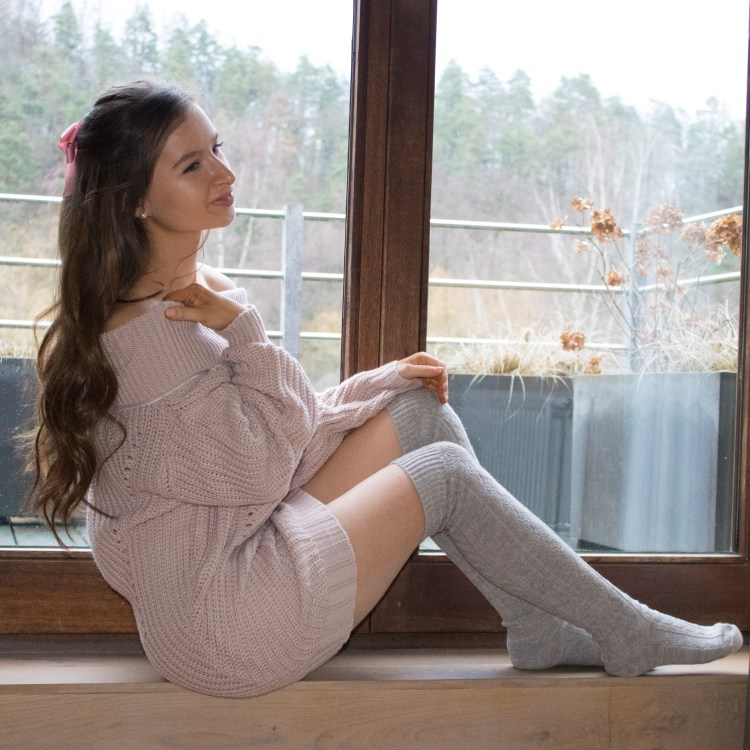 Pink sweater dress with pink ribbon and over the knee socks