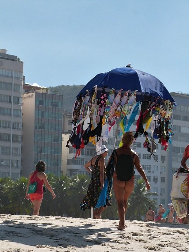 Swimsuit saleswoman on Copacabana Beach in Rio