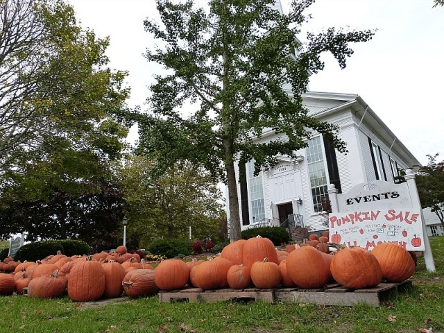 Pumpkin sale in New England - one of the reasons to experience fall in North America