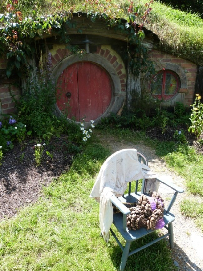 Outside a hobbit hole at Hobbiton New Zealand