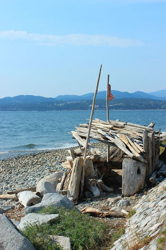 Finding a driftwood fort on Sechelt beach on Canada's Sunshine Coast during month two of digital nomad life