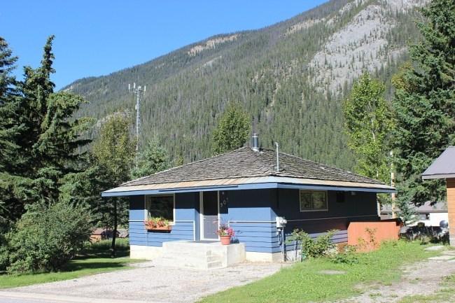 The little blue Help X staff house in Field