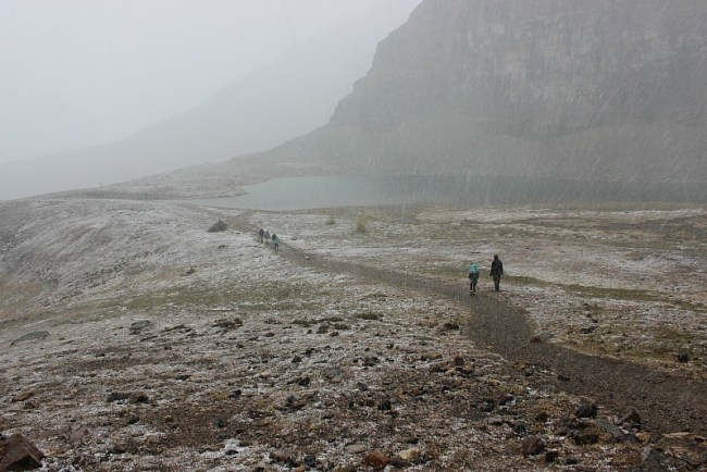 Snow falling near Sentinel Pass - one of the best fall hikes in Banff National Park