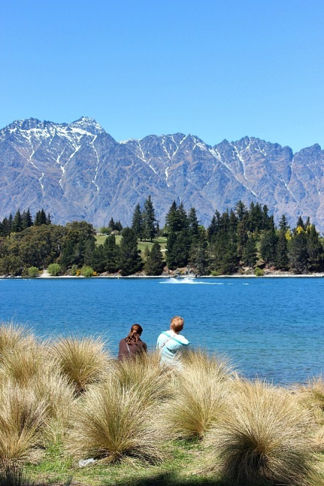 Sitting by the lake in Queenstown, in the Otago Region of New Zealand