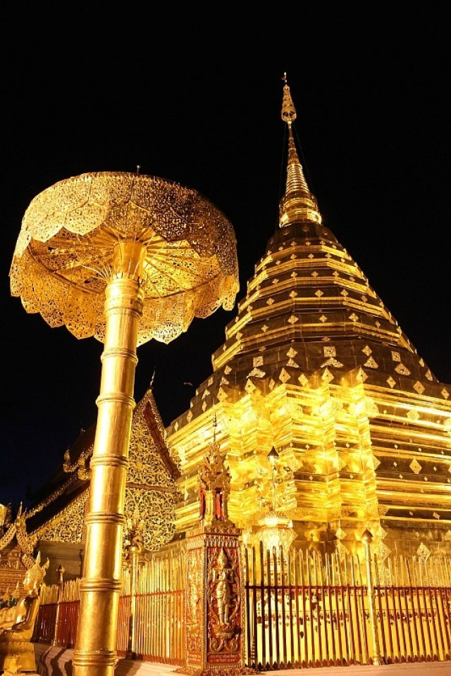 Golden temple at night in Chiang Mai, Thailand