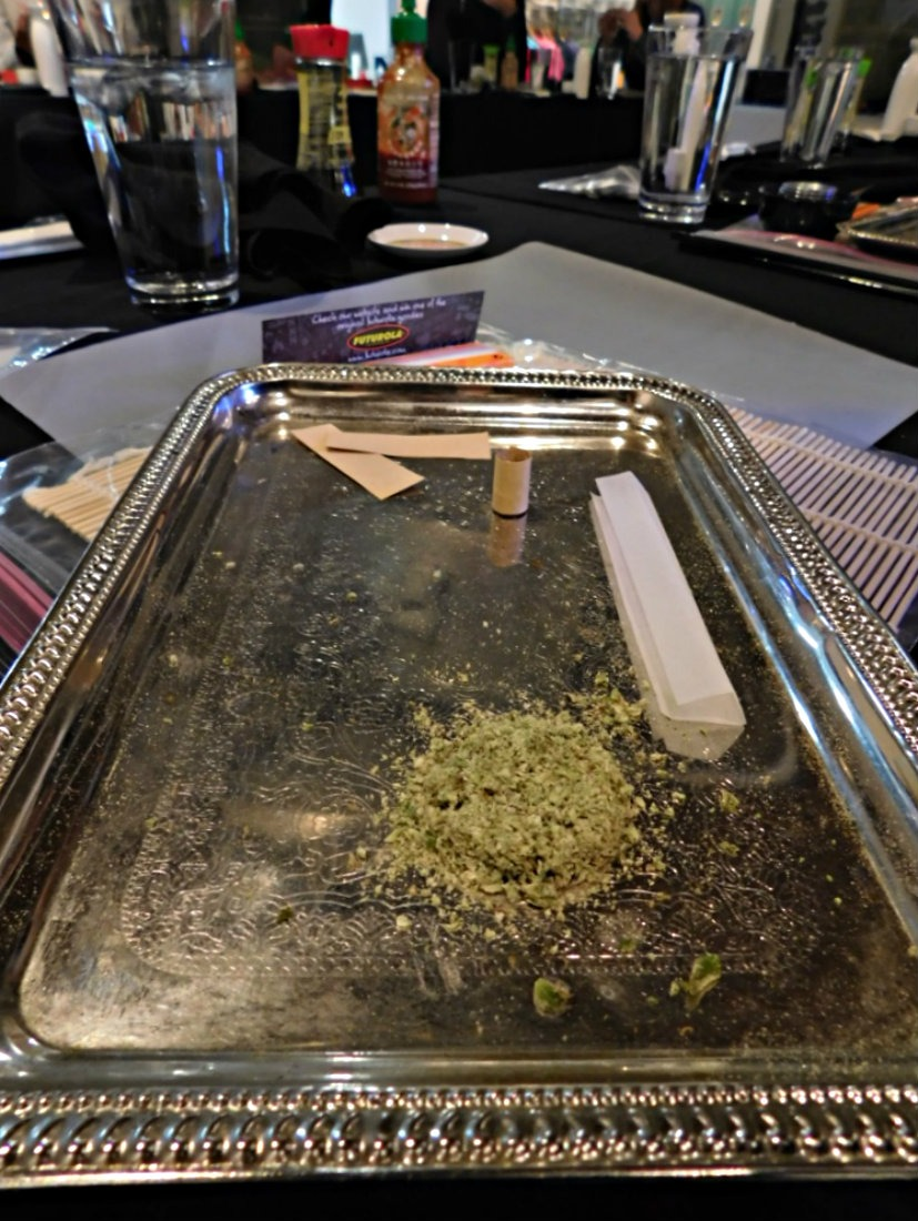 Learning how to roll joints at a sushi and joint rolling class with My 420 Tours - leaders in Cannabis Tourism in Denver