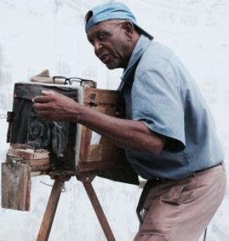 Man-taking-photos-in-Cuba-Havana