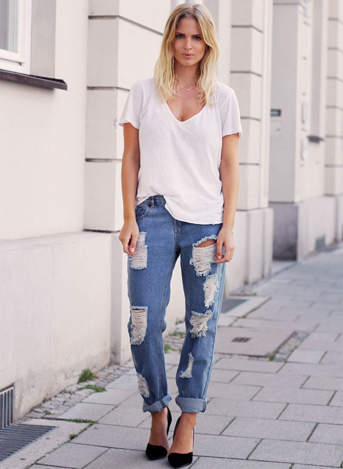 White tee, distressed boyfriend jeans, and simple black pumps