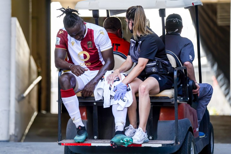Andrew Jean-Baptiste of Valour FC gets carted off after suffering a first-half injury.