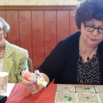 Women participating in designer purse bingo