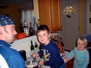 Jack (center) and Nathan (right) making pancakes with Uncle Ken - Oct. 2002.