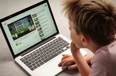 A Child watching Youtube videos on a laptop computer