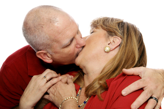 Middle age man kissing his wife © Lisa F. Young | dollarphotoclub.com