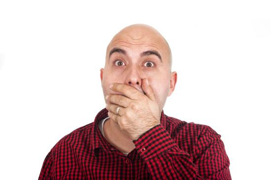 Man covering his mouth © Igor| dollarphotoclub.com