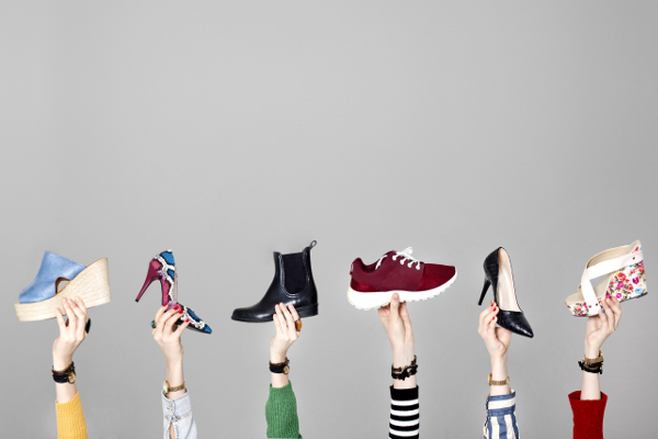 Women holding up different shoes