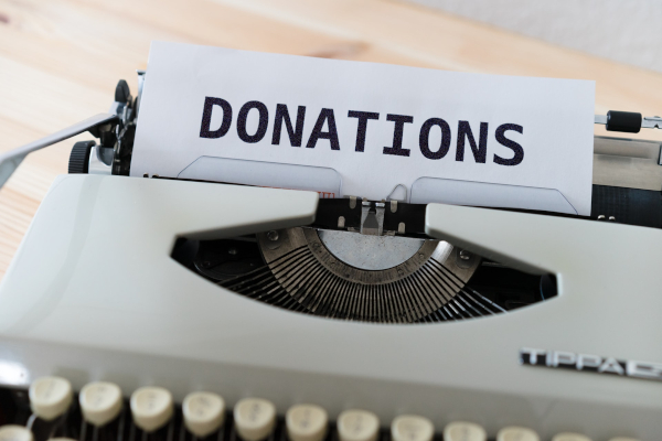 """Paper in typewriter reading """"donations"""""""