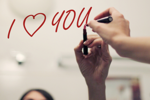 Inscription I LOVE YOU by lipstick on mirror