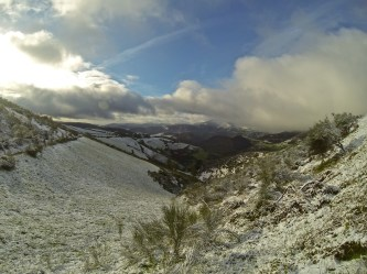 Hey, remember all those weeks of perfect weather we had?? Say bye-bye to it, because we entered Galicia (northwest Spain), and it rained on us like crazy as we walked up this valley the previous day. Overnight it turned to snow, so we got a great view the next morning.
