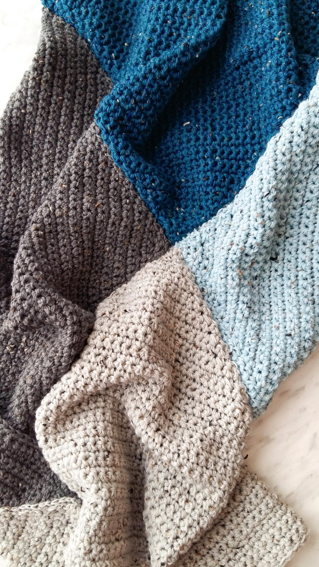 This simple crochet blanket can make quite an impact! Choose bold colours for a DIY crochet baby blanket that will endure for years!