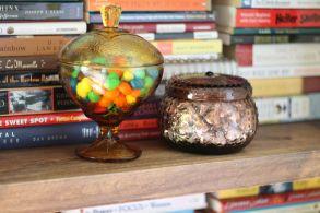 candy bowls on bookshelf