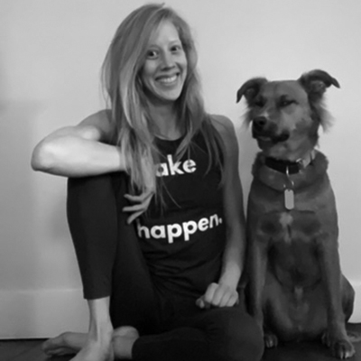 Yoga teacher Jessica Spivey poses with her doggie