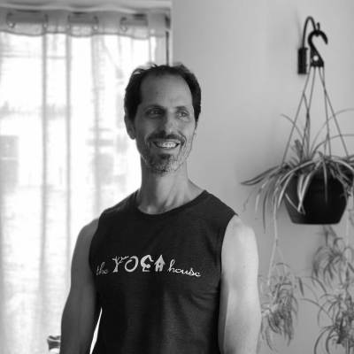 Michael poses in a Yoga House t-shirt inside the studio