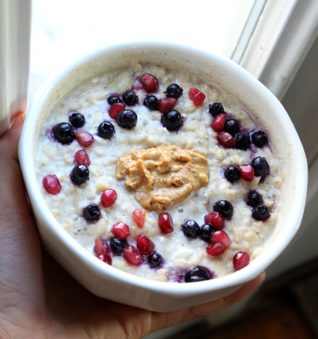 overnight oats with peanut butter, bloobs, and pom arils