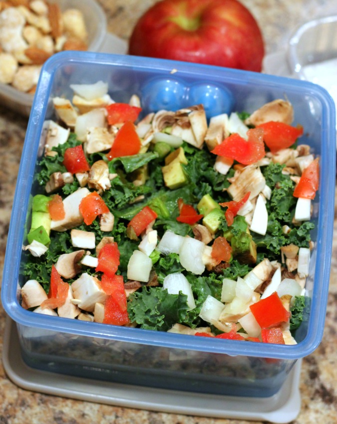 kale salad with onion tamoto avocado and mushroom